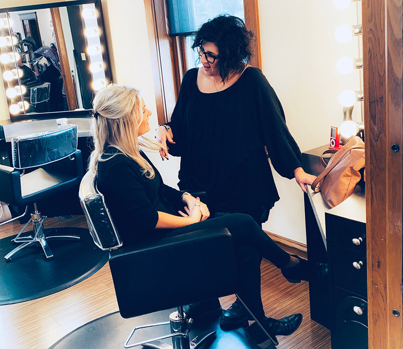 stylist consulting with a customer