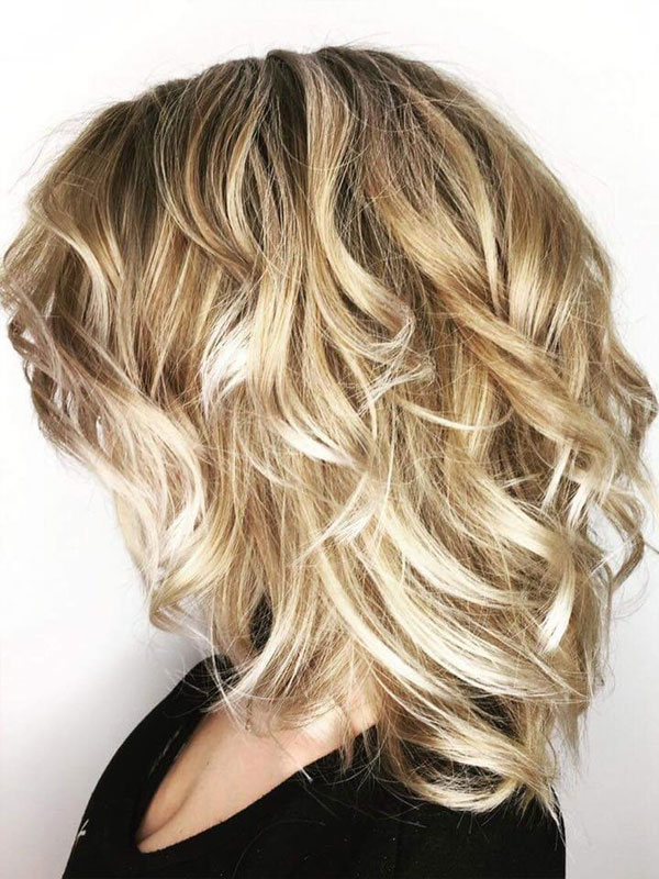 Short and curly blonde hair