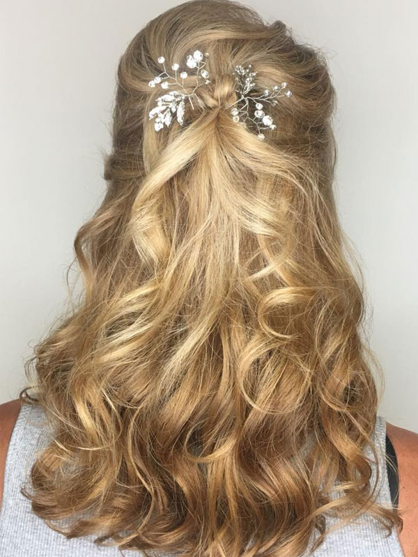 curly blonde hair with babys breath sprig