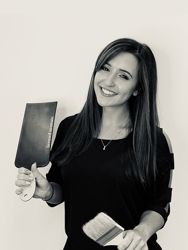 photo of Chrissy holding stylist tools