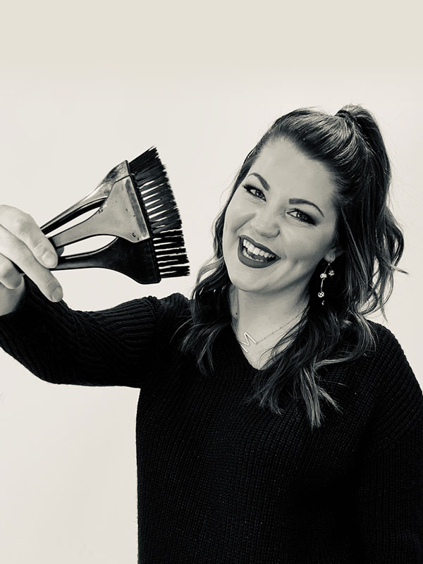 photo of Monica holding hair dye brushes