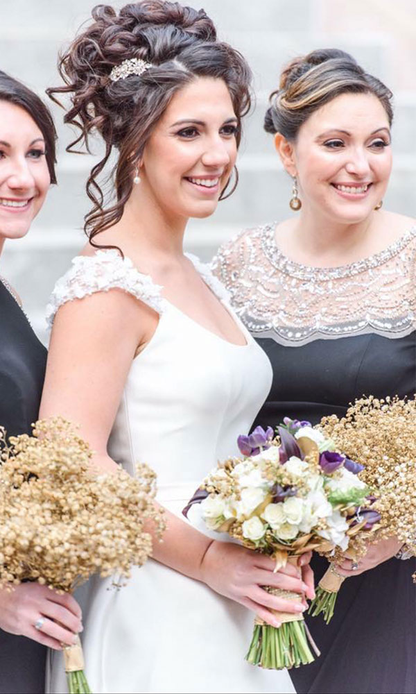bride with flowers and curly updo